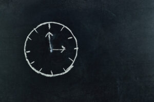 image of clock on chalkboard