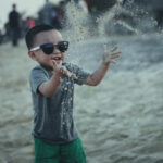 boy throwing sand