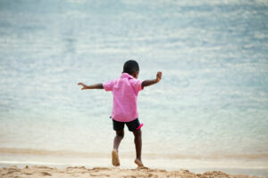 boy playing on shore