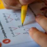 image of kid working on math