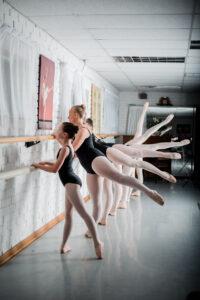 girls taking ballet class