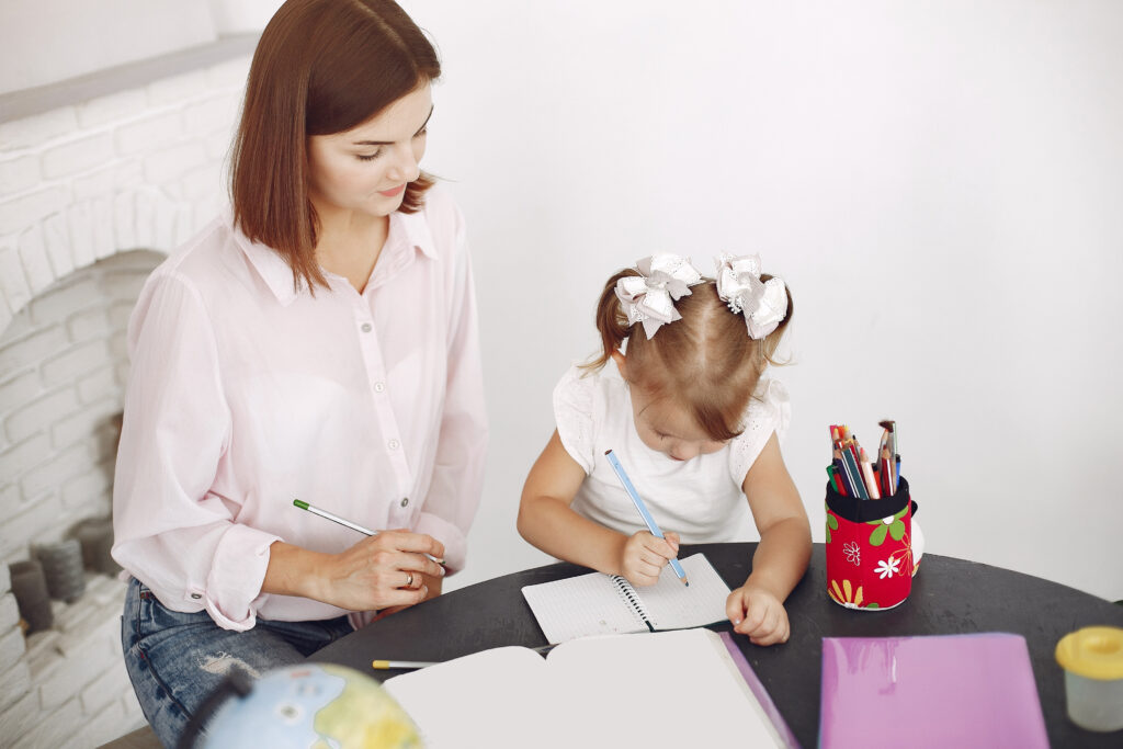 child with parent learning at home