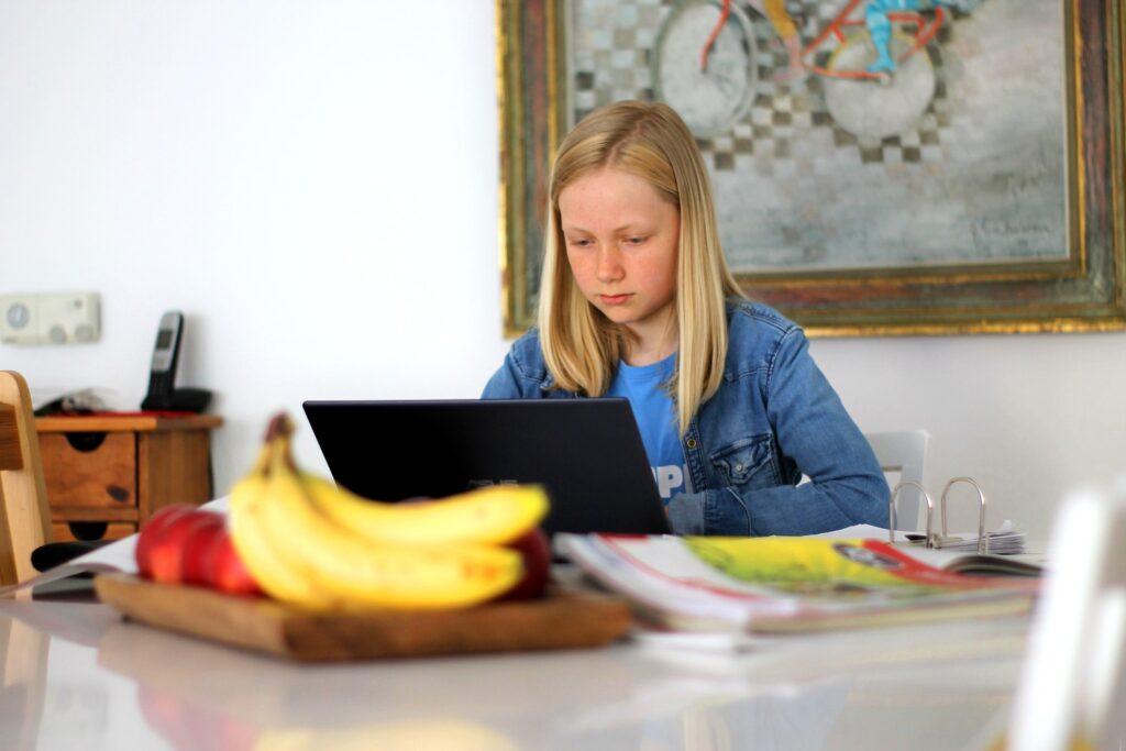 young girl homeschooler